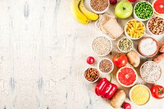 Healthy carbohydrates ingredients. Diet food background concept, healthy carbohydrates carbs products - fruits, vegetables, cereals, nuts, beans, light concrete stock photography
