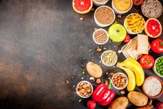 Healthy carbohydrates ingredients. Diet food background concept, healthy carbohydrates carbs products - fruits, vegetables, cereals, nuts, beans, dark blue royalty free stock images