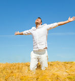 Healthy carefree man. Carefree man standing in golden wheat field being happy enjoing freetime Royalty Free Stock Images