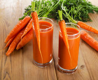 Healthy carrot juice on a wooden table Royalty Free Stock Photography