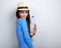 Healthy casual woman in summer hat holding bottle of pure water Royalty Free Stock Photography