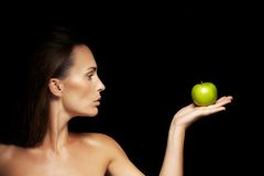 Healthy caucasian woman with apple Royalty Free Stock Photography