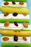 Healthy Celery Sticks. Healthy afternoon snack of celery sticks with cream cheese and sultanas Stock Image