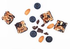 Healthy cereal bar with almond and blueberries. Healthy cereal bar with almonds and blueberries on white background royalty free stock photography