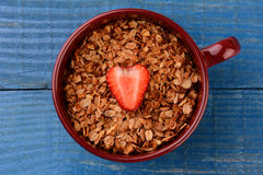 Healthy Cereal in Mug With Strawberry Stock Photography