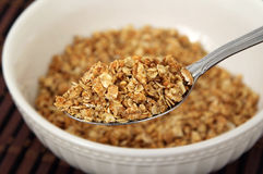 Healthy cereal on spoon. Selective focus Stock Images