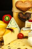 Healthy cheese. Different types of cheeses with tomato and chili pepper on the kitchen board. Preparation of healthy food. Healthy cheese. Different types of royalty free stock image