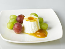 Healthy cheese and fruit dessert. Isolated dessert of cheese honey and fruit on white background Stock Images