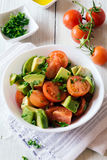 Healthy  cherry tomatoes and avocado salad Stock Photos