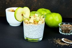 Healthy chia pudding with apples and granola in glass. Stock Image
