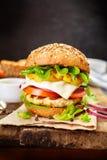 Healthy chicken hamburger, whole grain bun with fresh vegetables Stock Photography