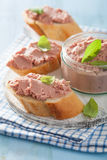Healthy chicken liver pate with sage in jar and on bread Stock Photos