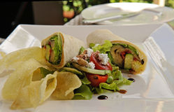 Healthy chicken sandwich wrap with potato crisps Royalty Free Stock Images