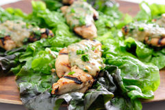 Healthy chicken tenders wrapped in lettuce Stock Photos