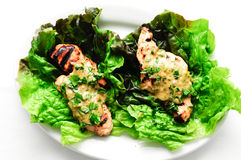 Healthy chicken tenders wrapped in lettuce Stock Photography