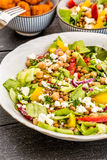Healthy chickpea salad. With vegetables and feta in a bowl, food closeup Stock Photos