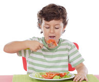 Healthy child eating Royalty Free Stock Image