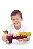 Healthy child with fresh beetroot juice Stock Photos