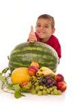 Healthy child and fresh fruits. Healthy boy and fresh banana melon watermelon grapes peach Royalty Free Stock Photo
