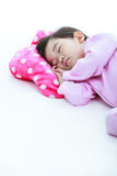 Healthy children concept. Asian girl sleeping peacefully. On whi Stock Photography