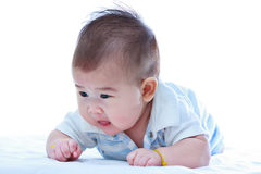 Healthy children. Cute crawling baby. Adorable baby girl, on whi Stock Photos