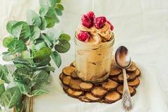 Healthy chocolate banana ice cream, raspberries in a glass jar Royalty Free Stock Photography