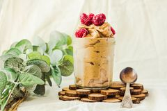 Healthy chocolate banana ice cream, raspberries in a glass jar Stock Photography