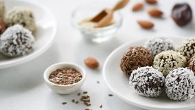 Chocolate protein energy balls vegan candy. Healthy Chocolate Protein energy balls vegan candy on white plate. Vegan truffles stock video footage
