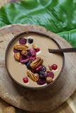 Healthy chocolate smoothie with berries and nuts. Chocolate smoothie with frozen berries and pecan nuts Royalty Free Stock Photography