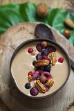 Healthy chocolate smoothie with berries and nuts. Chocolate smoothie with frozen berries and pecan nuts Stock Image