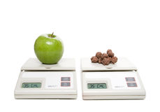 Healthy Choice. A scale with an apple and one with chocolate Stock Images