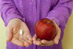 Healthy choice - pills or apple Royalty Free Stock Photography