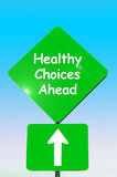 Healthy choices ahead. Sign with arrow on free against blues sky background Royalty Free Stock Images