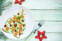Healthy Christmas appetizer snack - avocado salmon cranberry Chr Royalty Free Stock Photo