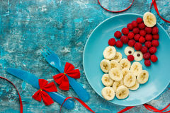 Healthy Christmas dessert snack breakfast for kids - raspberry b. Anana cute Santa stock photos