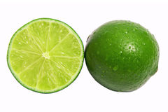 Healthy citrus fruity food. Whole and Slice of fresh lime isolated on white background Royalty Free Stock Image