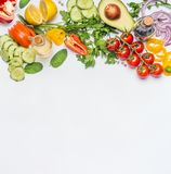 Healthy clean eating layout, vegetarian food and diet nutrition concept. Various fresh vegetables ingredients for salad. On white table background, top view Stock Images