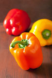 Healthy colorful bell peppers on rustic background Royalty Free Stock Photography