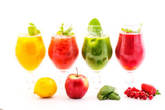 Healthy colorful smoothies with fresh fruits isolated on white background. Detox and diet food concept and background Royalty Free Stock Images