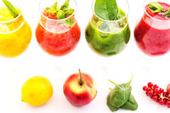 Healthy colorful smoothies with fresh fruits isolated on white background. Detox and diet food concept and background Stock Image