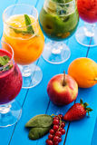 Healthy colorful smoothies with fresh fruits on wooden background. Detox and diet food concept and background Stock Photo