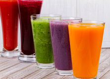 Healthy Colorful Smoothies with Fruits and Vegetables Against a Rustic Wooden Background Stock Photo