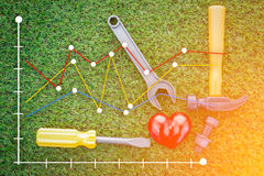 Healthy concept with red heart and tools. jpg. Healthy concept with red heart and tools on grass background view from top stock photos