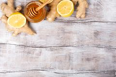 Copy free space. Healthy concept. Lemon, ginger, honey on a white wooden background. Flat lay. Treatment of cold and stock image