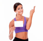 Healthy concerned brunette with copy space. Healthy brunette woman crossing her fingers and biting her lip with holding copy space, looking at camera while stock photo