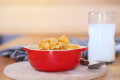 Healthy continental breakfast consists of cup of milk, bowl of c Stock Photo