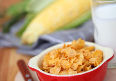 Healthy continental breakfast consists of cup of milk,Red bowl o Stock Photos