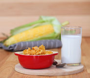 Healthy continental breakfast consists of cup of milk,Red bowl o Royalty Free Stock Images