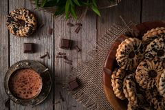 Healthy cookies and a cup of hot cocoa with chocolate. Royalty Free Stock Image