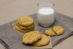 Healthy cookies from the peanut butter and milk on linen napkin Stock Image